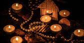 Seasonal home celebration with cones and candles — Stock Photo