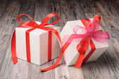 Two white boxes with red and pink bows — Stock Photo