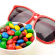 Stock Photo: Red sunglasses and colorful candies