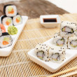 Rice sushi with seeds and soy sauce — Stock Photo