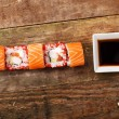 Orange sushi on a wooden plank — Stock Photo