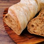 Italian bread cut into two halves — Stock Photo #42199603
