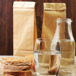 Two paperbags, a bottle of water and bread — Stock Photo