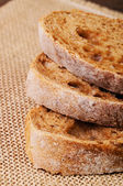Three slices of ciabatta bread — Stock Photo