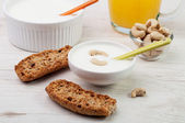 Two plate with yogurt with nuts and crunchy bread — Stock Photo