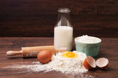 Flour, eggs and a bottle of milk — Stock Photo
