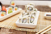 A set of deluxe asian sushi and chopsticks — Stock Photo
