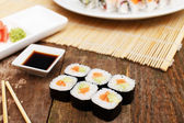 A set of salmon sushi on a wooden table — Stock Photo