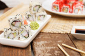 A set of sushi on a plate and chopsticks — Stock Photo