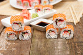 Six sushi on a wooden table — Stock Photo