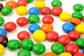 Vibrant picture of different color coated candies — Stock Photo