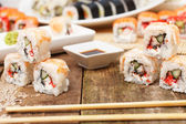 Several sushi with chopsticks on the table — Stock Photo