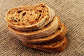 Sliced baguette on a sackcloth — Stock Photo