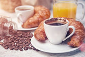 Cups of coffee with croissants — Stock Photo