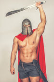 Barbarian with weapon — Stock Photo