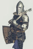 Knight with weapon — Stock Photo