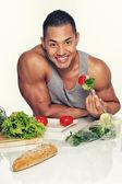 Man eating vegetables — Stock Photo