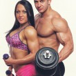 Couple with dumbbells — Stock Photo