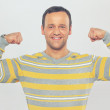 Handsome man showing his biceps — Stock Photo #44056605