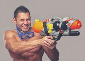 Man with water gun — Stock Photo