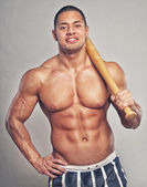 Muscle man with baseball bat — Stockfoto