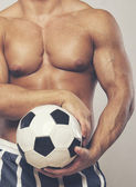 Muscle man  with ball — Stock Photo