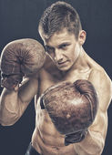 Guy with old boxing gloves — Stock Photo