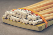 Colorful pencils with a ribbon around them — Stok fotoğraf