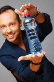 Man with bottle of water — Stock Photo