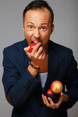 Man and apples — Stock Photo