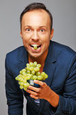 Man with grapes — Stock Photo