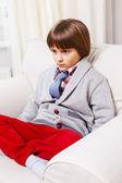 Boy on white sofa — 图库照片