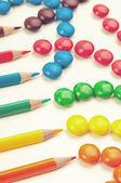 Candies and pencils — Stockfoto