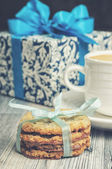 Blue gift box with cookies — Stock Photo
