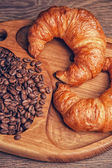 Croissants and coffee beans — Foto Stock