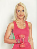 Blond with dumbbell — Stock Photo