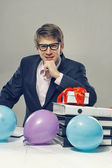 Man with color balloons and gift box — Stock Photo