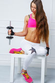 Young girl with a dumbbell — Foto Stock