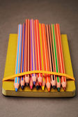 Pencils with notebook — Stock Photo