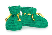 Pair of green knit baby bootees — Stock Photo