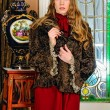 Beautiful woman in fur coat. The luxurious antique interior. — Stock Photo #12429871