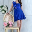 Stock Photo: Beautiful woman in blue dress in luxury interior.