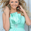 Beautiful blonde woman in a blue dress. - Stok fotoraf