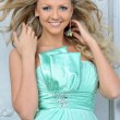 Beautiful blonde woman in a blue dress. - Stockfoto