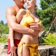 Beautiful man and woman holding on the beach. — Stock Photo