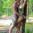 Beautiful man and woman holding and kissing on the nature. — Stock Photo