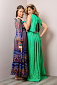Two beautiful woman in long dresses. — Stock Photo