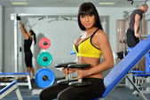 Beautiful woman doing exercises in a sport club. — Stock Photo