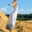 Beautiful woman posing at the sand place. — Stock Photo #12900379