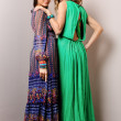Two beautiful woman in long dresses. — Stock Photo #12900777